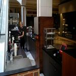 Indoor kiosk with coffee equipment and waffle set up!